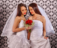 Wedding lesbians girl in bridal dress keeps flowers. Wedding lesbians girl in bridal dress. Roses bouquet Royalty Free Stock Image