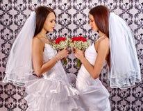 Wedding lesbians girl in bridal dress Stock Image