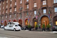 Wedding limo - coach near the hotel Astoria Royalty Free Stock Photos