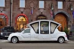 Wedding limo - coach near the hotel Astoria Stock Photos