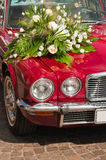 Wedding limousine. Luxury red wedding car decorated with flowers Royalty Free Stock Image
