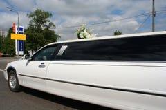 Wedding limousine. The wedding white limousine rushes on road Royalty Free Stock Image