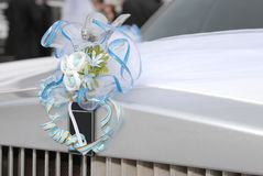 Wedding limousine. Decoration on the white wedding limousine Royalty Free Stock Photography