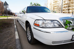 Wedding limousine on city street Royalty Free Stock Photo