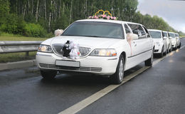 Wedding limousine with ex-court Royalty Free Stock Photos