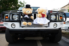 Wedding limousine with toys bears Royalty Free Stock Photography
