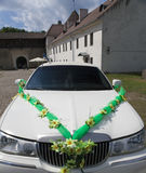 Wedding limousine in the yard of fortress Narva, Estonia - a traditional place of wedding ceremonies of citizens. Royalty Free Stock Images