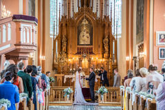 Wedding in Lithuanian church. In Kernave city royalty free stock photography