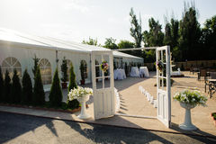 Wedding location. Entrance. White doors and white tent stock images