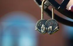 Wedding lock on a metal fencing on bridge in park Symbol of Love Royalty Free Stock Photos