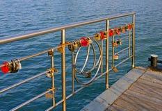 Wedding locks. On the metal railing near the sea Stock Photo