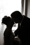 Wedding Love. Couple getting ready to kiss in front of a window stock photography