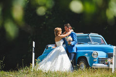 Wedding Love Story by Cabriolet. Wedding love story by old blue cabriolet Royalty Free Stock Photo