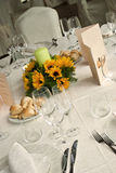 Wedding lunch. A well prepared table for the wedding lunch with a bunch of sunflowers in the middle,a candle,the menu Stock Photos