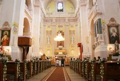 Wedding. LUTSK, UKRAINE - 24 May 2008: Interior of a christian church with a couple getting married Royalty Free Stock Photo