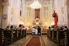 Wedding. LUTSK, UKRAINE - 24 May 2008: Interior of a christian church with a couple getting married Stock Photo