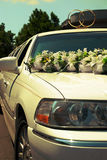 Wedding luxury white limousine awaiting in front of a palace Stock Photos
