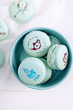 Wedding macarons with drawings. Delicate and elegant wedding turquoise macaroons with white cream and hand painted tea cups Stock Photo