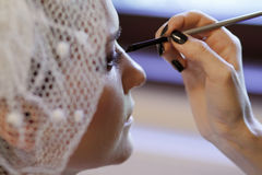 Wedding make-up. Portrait of young bride being make-up for the wedding preparations Stock Photos