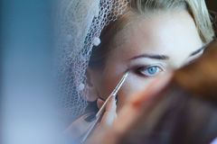 Wedding makeup. Portrait of young bride being makeup for the wedding