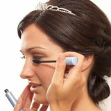 Wedding makeup. Young bride making her makeup for wedding ceremony stock photo