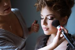 Wedding makeup artist making a make up for bride Royalty Free Stock Photo