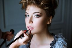 Wedding makeup artist making a make up for bride Royalty Free Stock Image