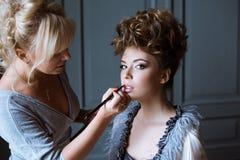 Wedding makeup artist making a make up for bride Stock Images