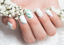 Wedding manicure for the bride in gentle tones Stock Images