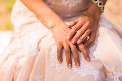 Wedding manicure. Bride in gown, emerald jewelry bracelet Stock Image