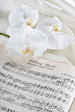 Wedding march and orchids. Sheet music wedding march and white orchids stock images