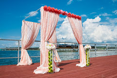 Wedding in marine style in coral color. Wedding ceremony in marine style in coral color Royalty Free Stock Photo