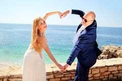 Wedding married couple of hands make a real heart Royalty Free Stock Images