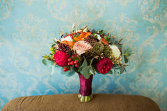 Wedding marsala bouquet with roses and other flowers on vintage Stock Photo