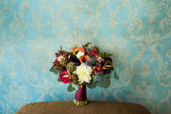 Wedding marsala bouquet with roses and other flowers on vintage Royalty Free Stock Photos