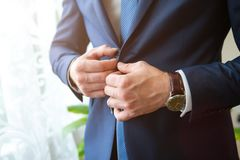 Wedding men`s hands button up. place for text stock photos