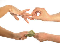 Wedding for money. Hands by imposing ring a second giving money Stock Photo