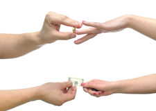 Wedding for money. Hands by imposing ring a second giving money Stock Image