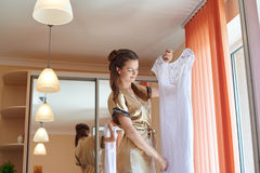 Wedding morning beautiful bride trying on a dress Royalty Free Stock Photography