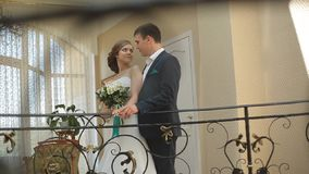 Wedding morning. First meeting of bride and groom in the bridal apartments before wedding ceremony stock footage