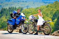 Wedding on the motorcycle. A just married couple, on the motorcycle stock photography