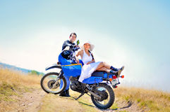 Wedding on the motorcycle. A just married couple, on the motorcycle stock images
