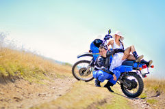 Wedding on the motorcycle. A just married couple, on the motorcycle royalty free stock images