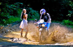 Wedding on the motorcycle. A just married couple, on the motorcycle royalty free stock photo