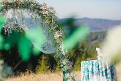 Wedding in mountains. Floral arch. Royalty Free Stock Photography