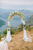 A wedding in the mountains. Wedding arch for the ceremony on the. Summit of Mount Lovcen in Montenegro Royalty Free Stock Photography