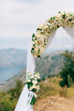 A wedding in the mountains. Wedding arch for the ceremony on the. Summit of Mount Lovcen in Montenegro Stock Images