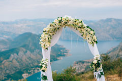 A wedding in the mountains. Wedding arch for the ceremony on the. Summit of Mount Lovcen in Montenegro Stock Photography