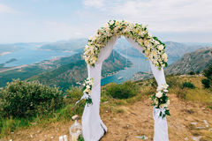 A wedding in the mountains. Wedding arch for the ceremony on the. Summit of Mount Lovcen in Montenegro Royalty Free Stock Photos
