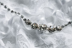 Wedding necklace and garter Stock Photo